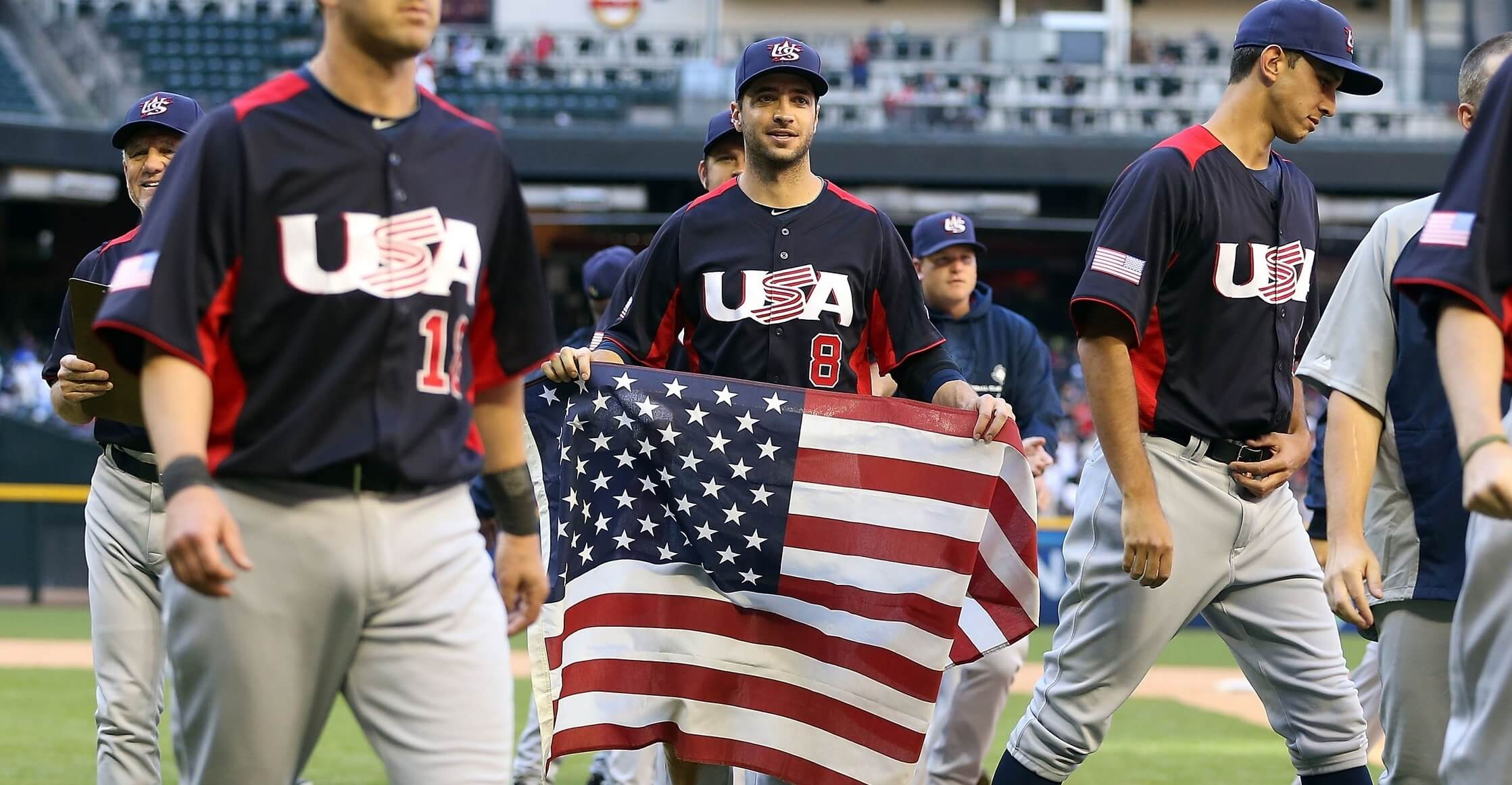 PHOENIX, AZ - MARCH 10:  Ryan Braun #9 of USA carries a flag in celebration after defeating Canada 9-4 in the World Baseball Classic First Round Group D game at Chase Field on March 10, 2013 in Phoenix, Arizona.  (Photo by Christian Petersen/Getty Images)